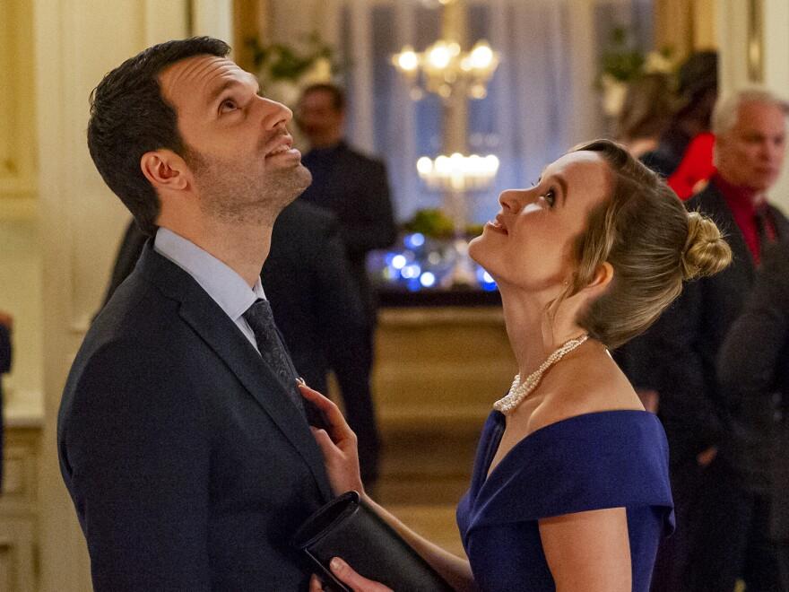 Jake Epstein and Kelly Jakle in <em>Mistletoe and Menorahs</em>.