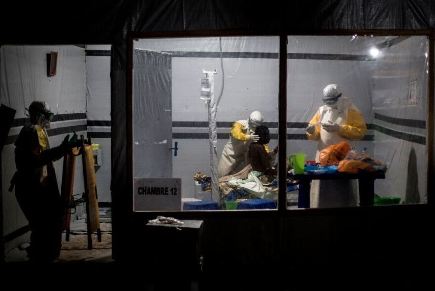Health workers treat a patient at the Ebola Treatment Center in the city of Butembo, in the Democratic Republic of Congo. It's one of three locations where researchers have been conducting a clinical trial of four experimental treatments for the disease.