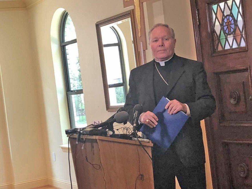 Bishop Edward J. Burns during the diocese's afternoon press conference at Holy Trinity Catholic Church on Oak Lawn, across the street from the diocese, in response to Wednesday's police raid.