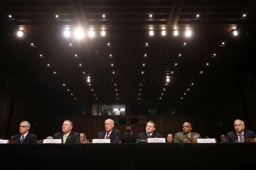 Acting FBI Director Andrew McCabe (from left), Central Intelligence Agency Director Mike Pompeo, Director of National Intelligence Dan Coats, National Security Agency Director Michael Rogers, Defense Intelligence Agency Director Vincent Stewart and National Geospatial-Intelligence Agency Director Robert Cardillo testifiy before the Senate Intelligence Committee.