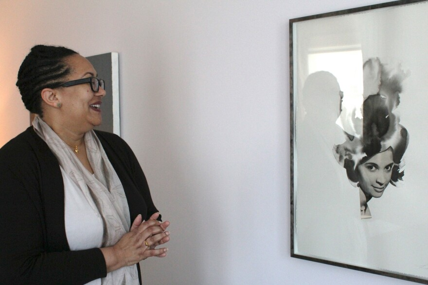 In this April 12 photo, arts advocate and law professor Adrienne Davis looks upon a piece by artist Lorna Simpson in her home collection.
