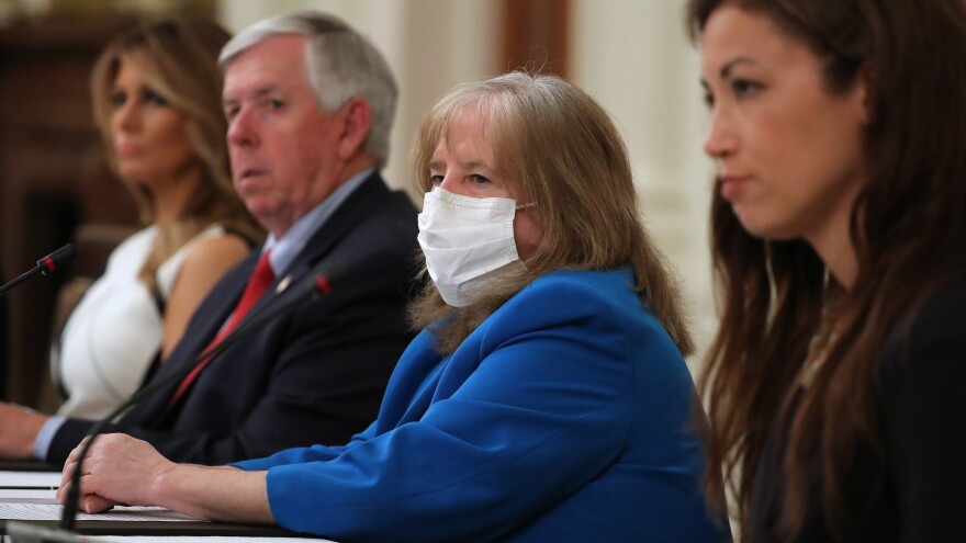 The president of the American Academy of Pediatrics, Dr. Sally Goza, attends a meeting at the White House with President Trump, students, teachers and administrators about how to safely reopen schools during the coronavirus pandemic.