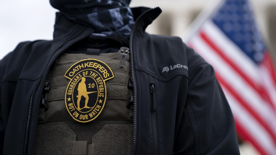 A demonstrator wears an Oath Keepers anti-government organization badge on a tactical vest during a protest outside the Supreme Court in Washington, D.C., on Jan. 5, 2021.