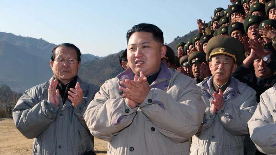 Kim Jong Un, who is expected to become North Korea's next leader, claps after inspecting the construction site of a power station. This undated photo was released by the Korean Central News Agency on Nov. 4, 2010.