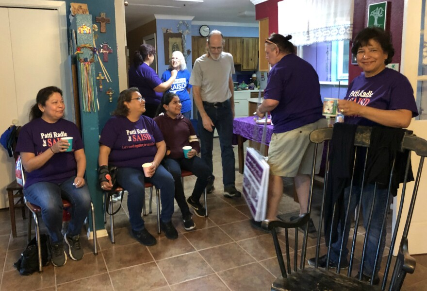 Volunteers eat breakfast tacos and gather signs at Patti and Rod Radle's home before heading out to block walk for the board president Apri. 13.