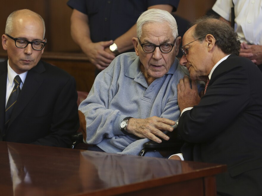 Anthony Marshall speaks to his attorney in criminal court in 2013 in New York. He surrendered to begin his prison term after years of fighting his conviction for defrauding his mother, socialite Brooke Astor.