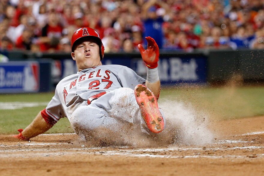 American League All-Star Mike Trout slides home Tuesday night during the 86th MLB All-Star Game at the Great American Ball Park in Cincinnati.