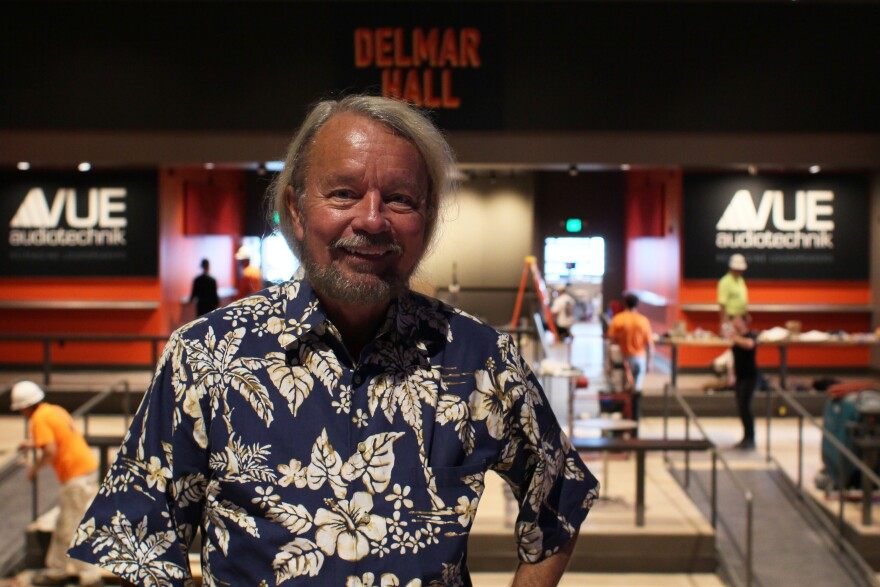 Joe Edwards, in Hawaiian shirt stands on the Delmar Hall Stage one day before the venue's grand opening.
