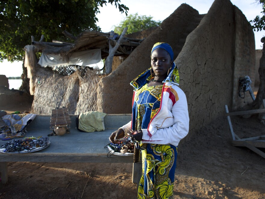Kadija, a jewelry vendor, stands next to her stall in Djenne on Aug. 31. In previous years, the town had nearly 10,000 annual tourists. But since March, fewer than 20 tourists have come to Djenne, according to the local tourism board.