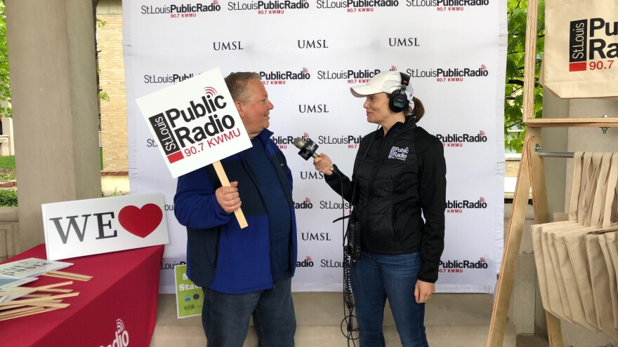 A Volunteer at St. Louis Public Radio's Earth Day Photo Booth