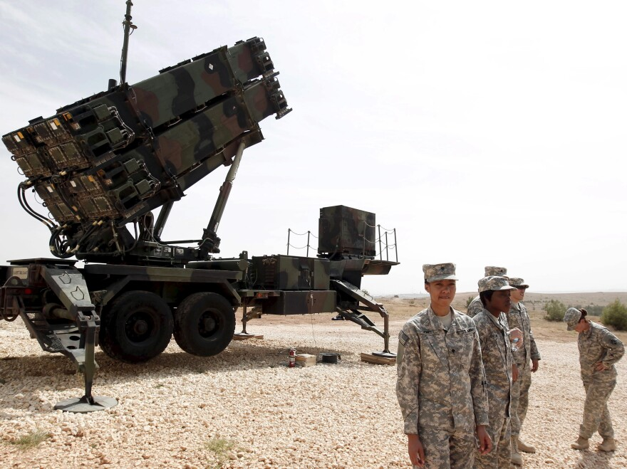 U.S. soldiers stand beside a Patriot missile system at a Turkish military base in Gaziantep, southeastern Turkey, last October. In a joint statement, Washington and Ankara said the missiles would be withdrawn for updating and modernization.