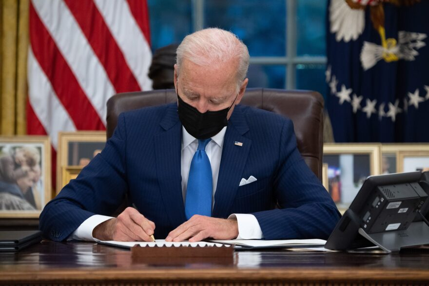 President Biden signs executive orders related to immigration in the Oval Office on Feb. 2, 2021. (Saul Loeb/AFP via Getty Images)