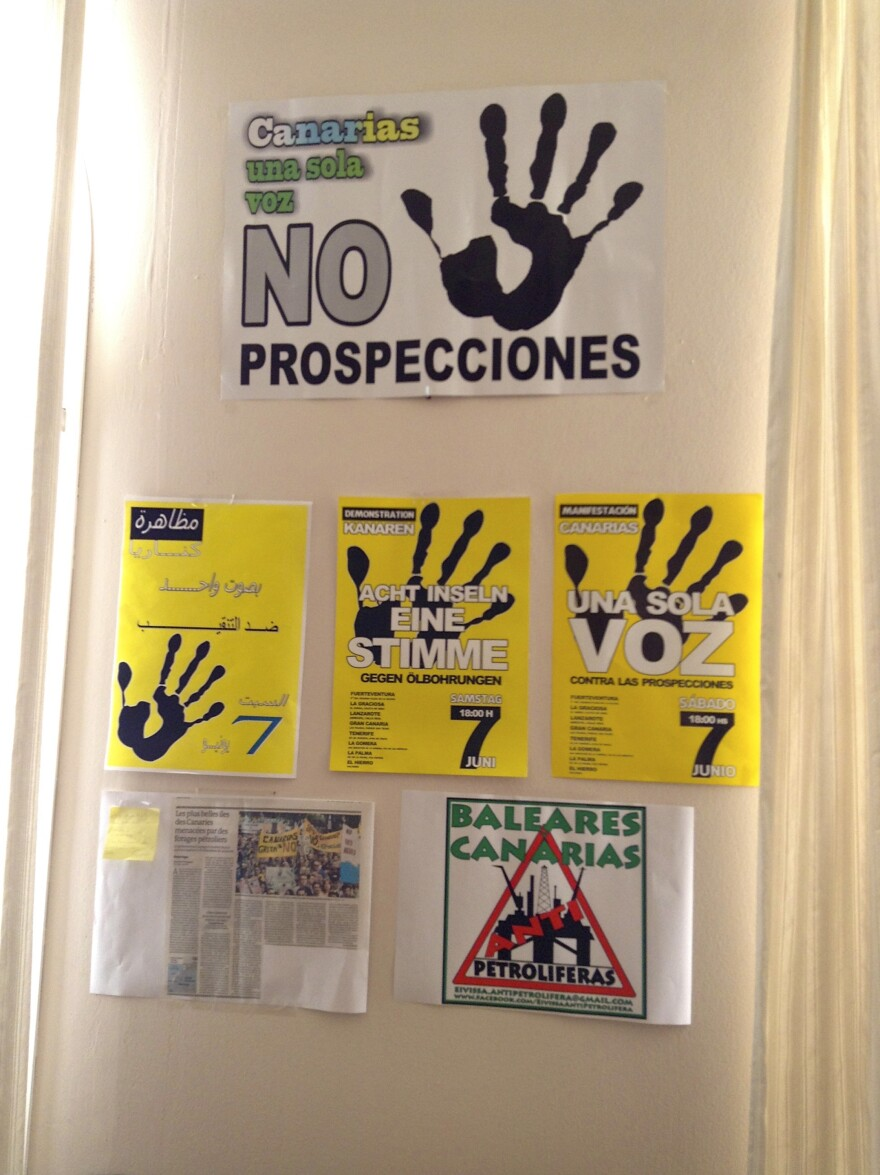 Local activists have printed posters in several languages (here shown in Spanish, Arabic and German) to try to convince tourists and locals to oppose oil drilling in the Canary Islands.