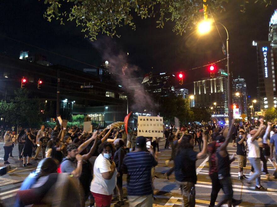 Protesters demonstrated near Charlotte-Mecklenburg Police Department headquarters Saturday night.