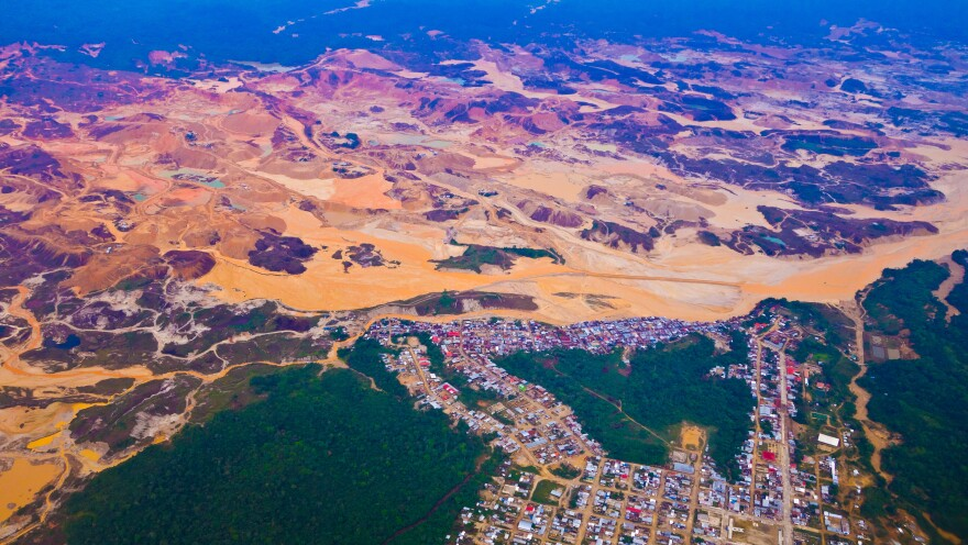 An aerial photo shows the environmental destruction in the wake of illegal gold mining in the Peruvian Amazon.