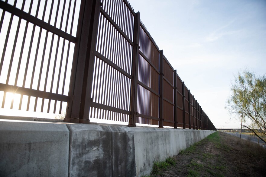 brown bollard fencing at Texas' southern border with Mexico