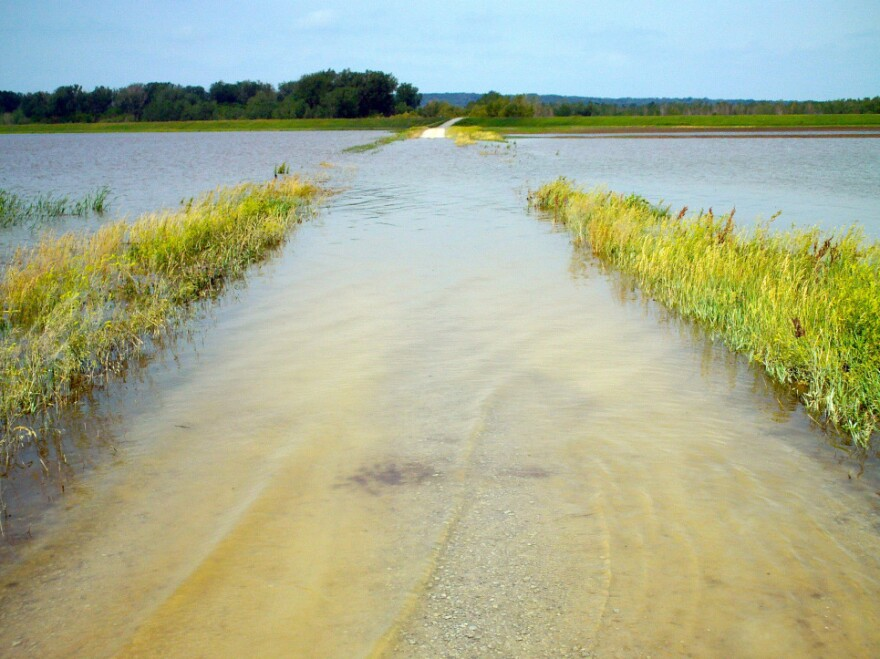 Roads around rural Hamburg, Iowa, were flooded Tuesday after the Missouri River ruptured two levees in northwest Missouri Monday. On Wednesday, water spilling through a nearly 300-foot hole in a levee near Hamburg threatened a secondary levee built to protect the town.