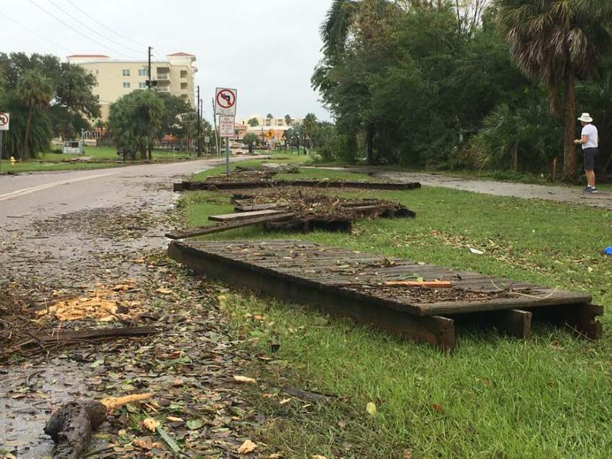 Parts of a pier and debris along Bayshore Boulevard in Safety Harbor