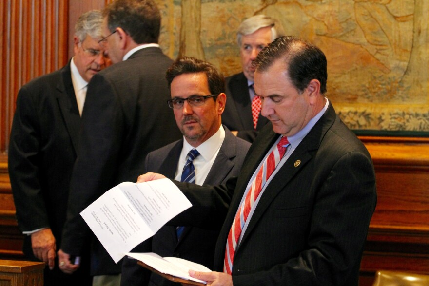 From center: Sens. Kurt Schaefer, R-Columbia, waits for a presser to start with Sen. Mike Kehoe, R-Jefferson City.