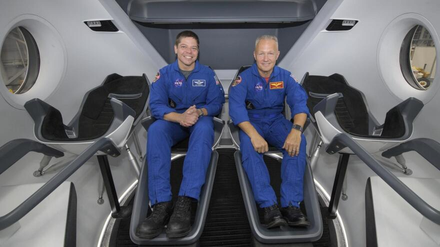 "Assuming the Crew Dragon flight tests go well, the first NASA astronauts set to launch aboard SpaceX's capsule are <a href=""https://www.nasa.gov/astronauts/biographies/robert-l-behnken"">Bob Behnken</a> (left) and <a href=""https://www.nasa.gov/astronauts/biographies/douglas-g-hurley"">Doug Hurley</a>."