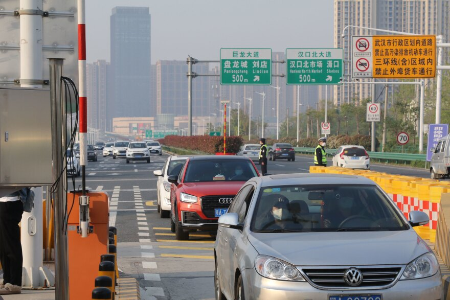 At midnight on April 8, all highway checkpoints installed on Jan. 23 were removed. Cars lined up on the road, waiting to leave after the intracity traffic ban was lifted.