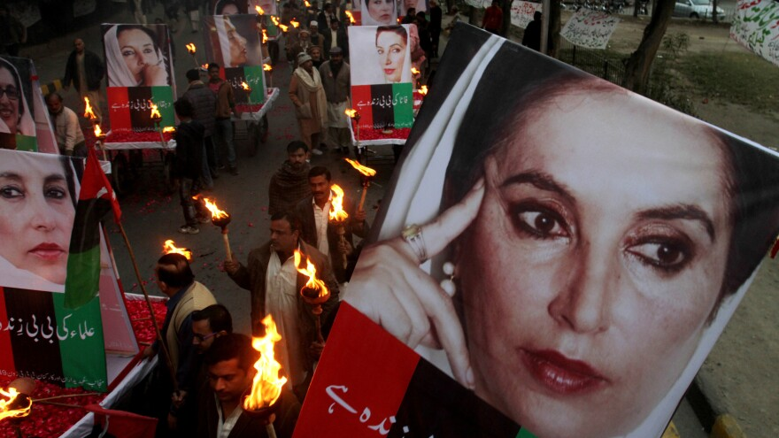 Supporters of Pakistan's slain leader Benazir Bhutto rally in Lahore, Pakistan, in 2013 on the sixth anniversary of her death.
