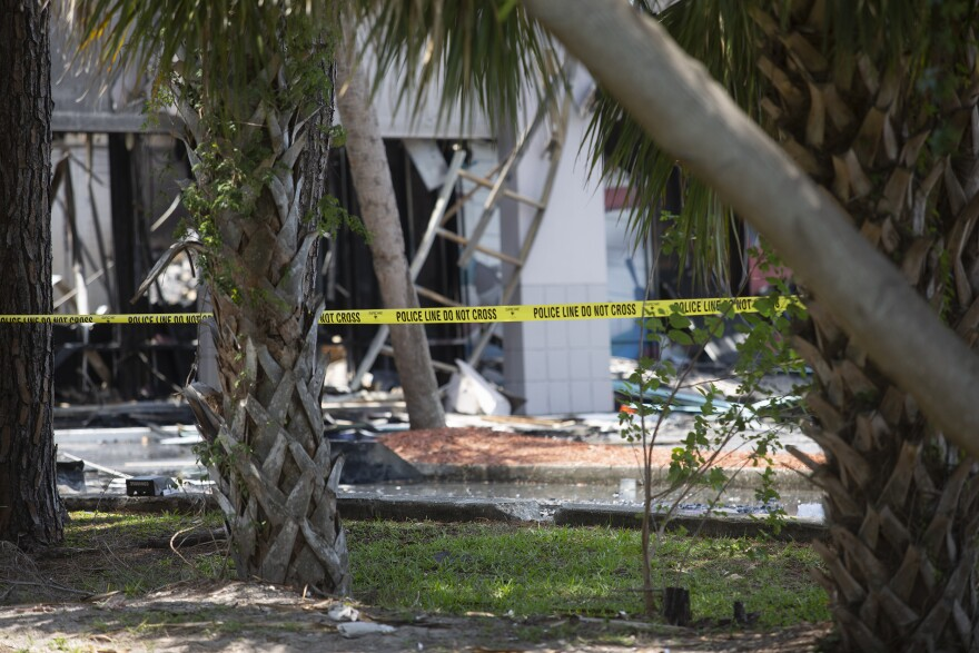 burned out building with police tape.