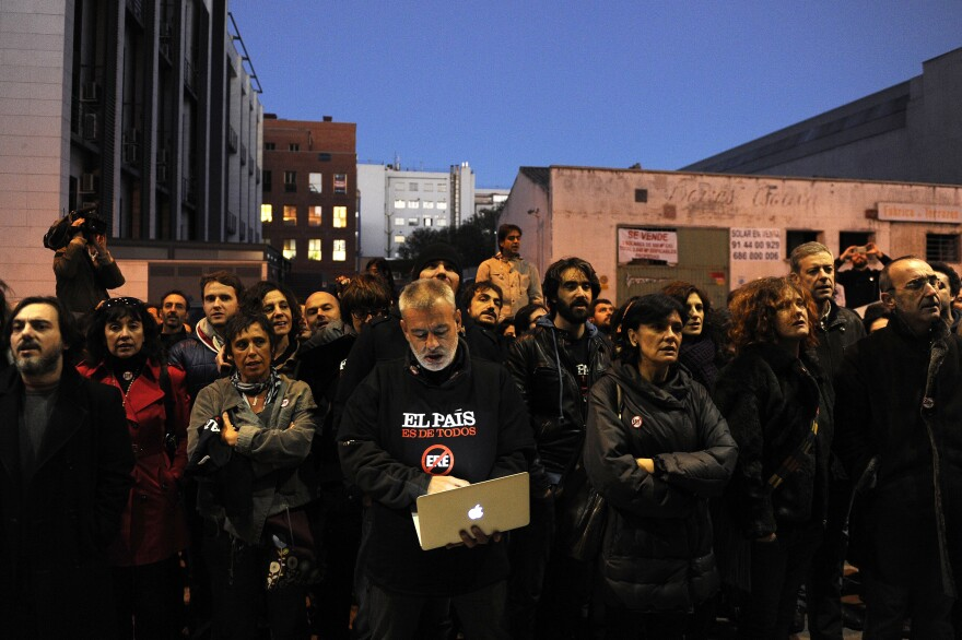 <em>El Pais</em> journalists demonstrate outside the newspaper's headquarters in Madrid last month.
