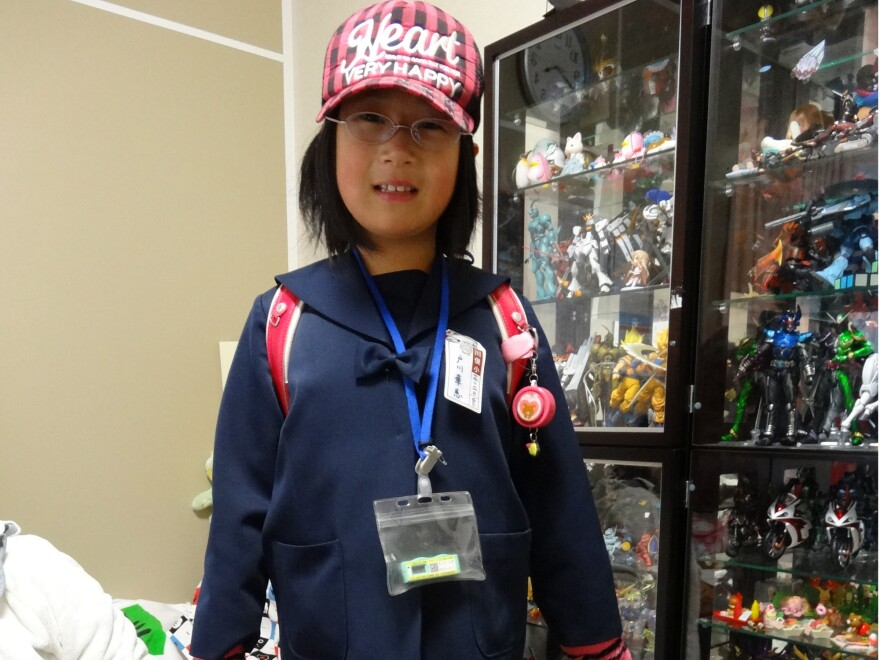 Kae Togawa, 9, must wear a radiation badge whenever she leaves the house.
