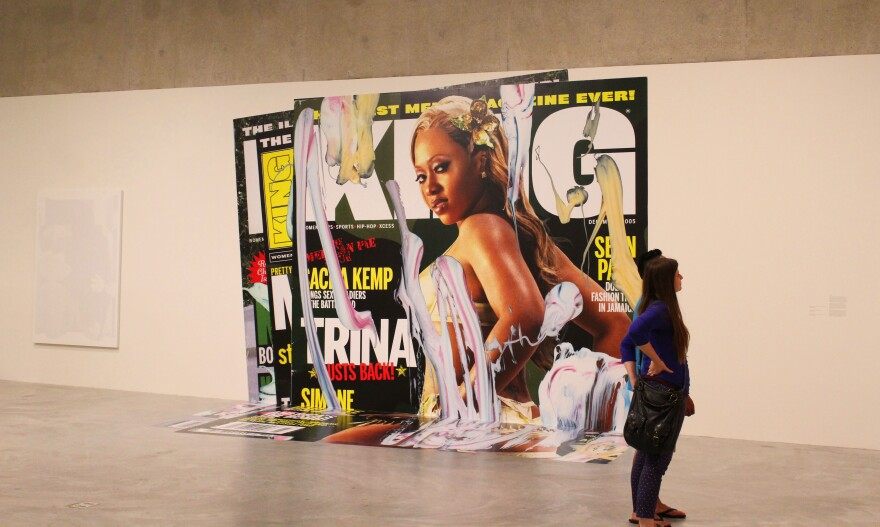 An art piece by Kelley Walker uses a floor-to-ceiling cover of a female rapper from men's magazine. It is smeared in tooth paste.