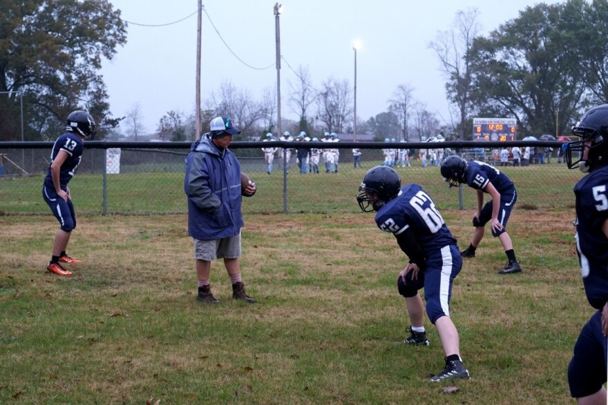 Hannan head football coach Kellie Thomas watches players warm up before their game against Parkersburg Catholic.