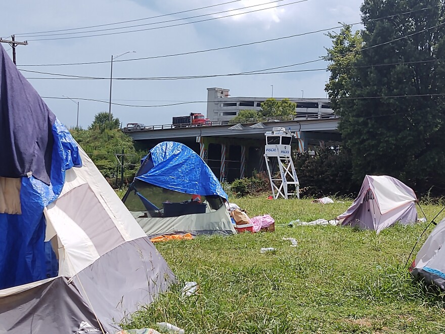 A police box sits next to the encampment off 12th Street, just east of uptown and I-277.