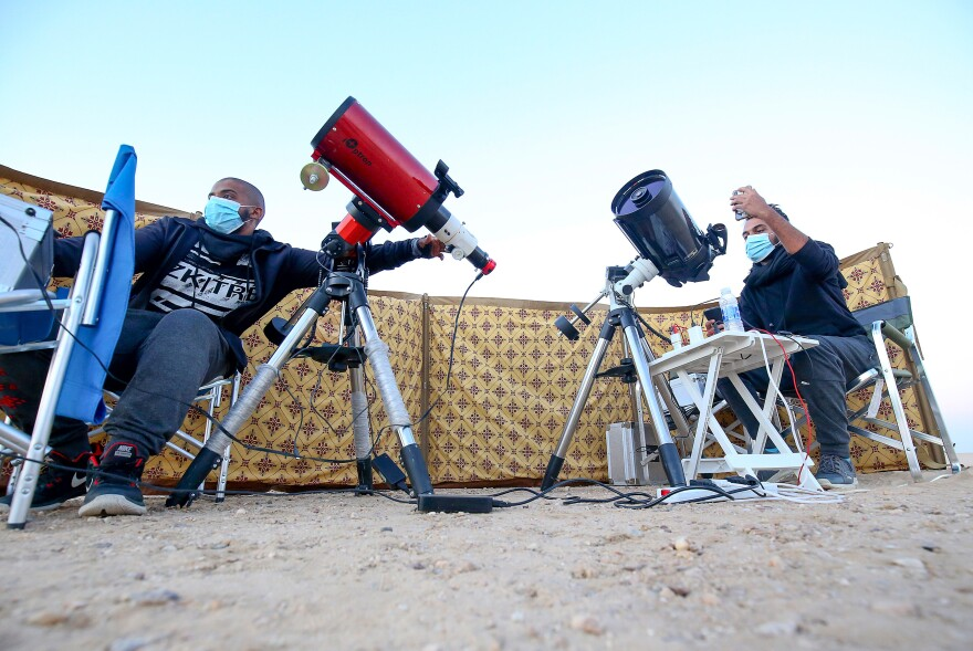Kuwaiti astrophotographers Mohammad al-Obaidi, right, and Abdullah al-Harbi follow the Great Conjunction between Jupiter and Saturn in al-Salmi district, a desert area west of Kuwait City