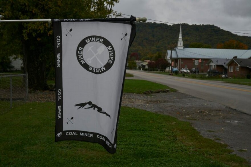 A coal miner's flag hangs in the front yard of a home in Middlesboro, Kentucky.
