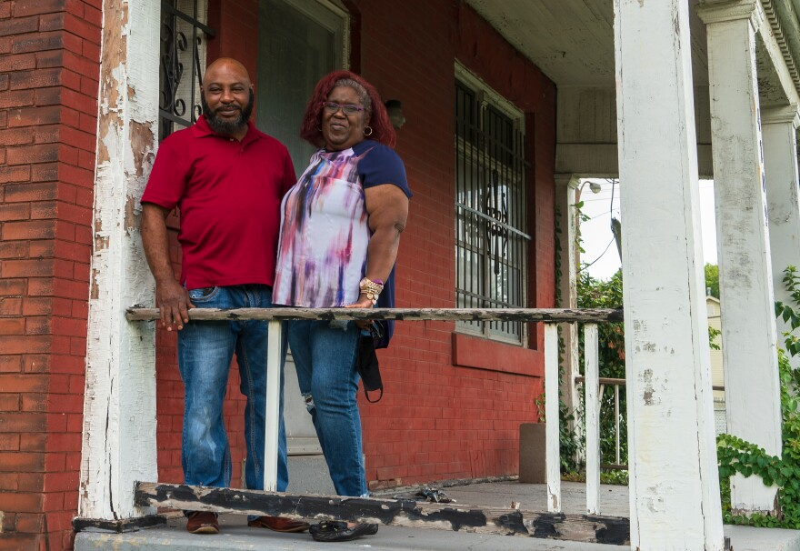 Damon Giboney and Patricia Dees stand on the porch of their home in St. Louis on July 29, 2020.