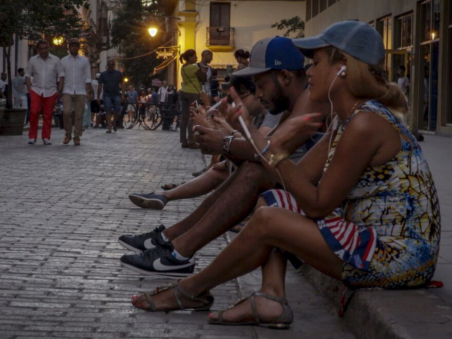 Google launched its first servers in Cuba this week. Above, people use public Wi-Fi to connect their devices on a Havana street in October 2016.