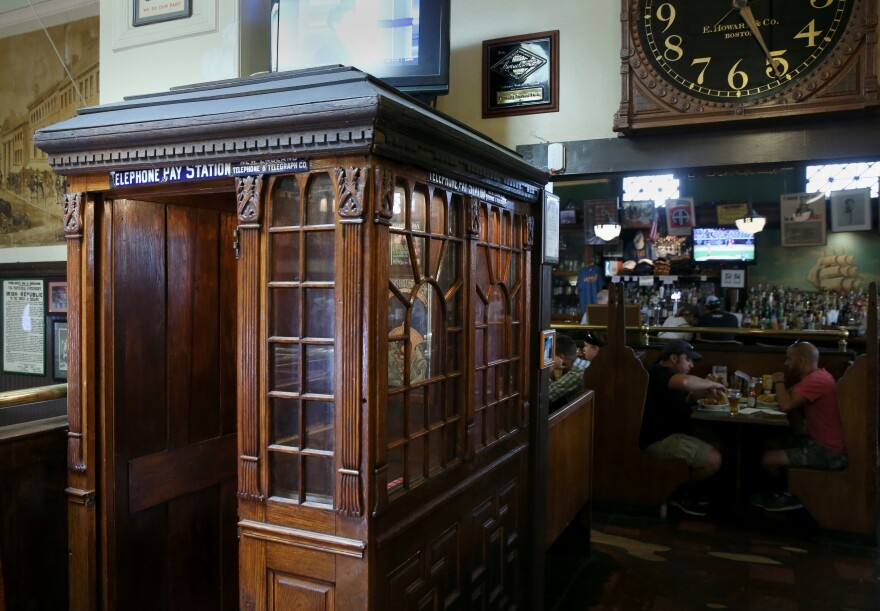 A telephone booth from 1882, which could only be used for receiving calls, is pictured at Doyle's Cafe in Boston, July 21, 2016. It is one of three telephone booths in the restaurant.