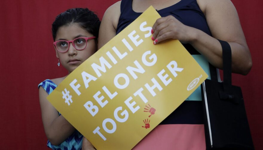 "A girl stands with her mother during a Rally For Our Children event to protest a new ""zero-tolerance"" immigration policy that has led to the separation of families, Thursday, May 31, 2018, in San Antonio. (Eric Gay/AP)"