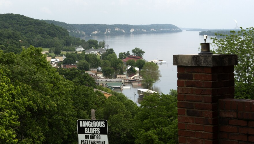 May 29, 2019 Downtown Grafton, seen from the Tara Point Inn, fends off the Mississippi River. The river had reached 32 feet, on its way to a projected crest of 36.3 feet, which would be the second highest on record and less than two feet below the record