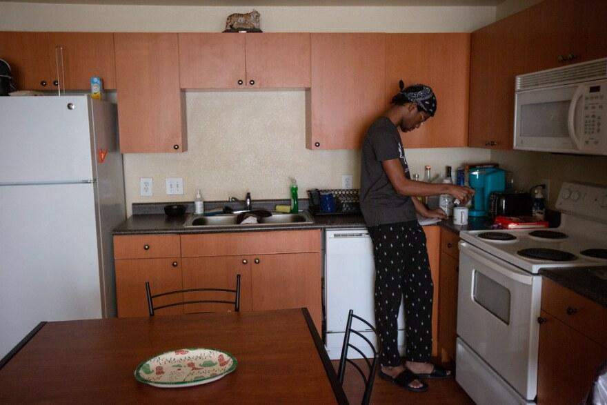 UT Austin student Malik Julien in his kitchen at Town Lake Apartments.