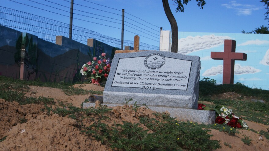 """In lieu of names, this headstone was engraved with a quote: """"We grow afraid of what we might forget. We will find peace and value through community in knowing that we belong to each other. Dedicated to the Citizens of Bernalillo County."""""""
