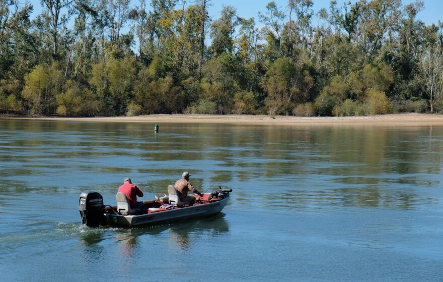 A pair of fishermen cross the Apalachicola River