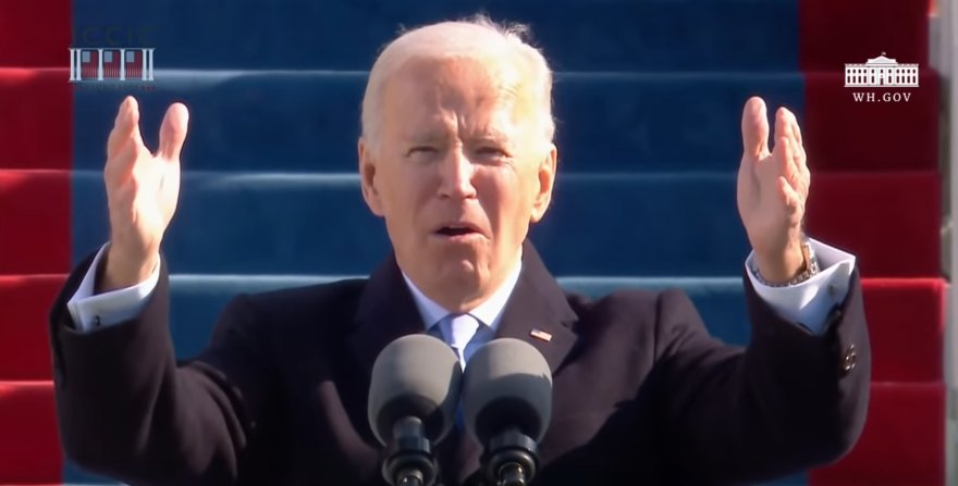 president biden arms outstretched speaking from a lectern