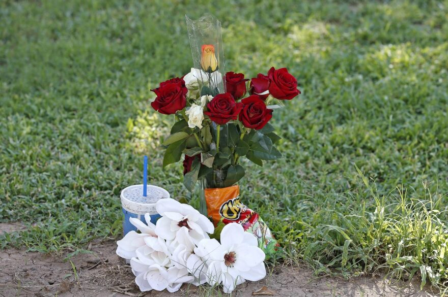 """The grave site of Manuel """"Manny"""" Castro Garcia, 19, at a cemetery Thursday, July 14, 2016, in Phoenix. The teen was killed in June, and is one of a growing number of victims associated with a serial killer according to police. (Ross D. Franklin/AP)"""