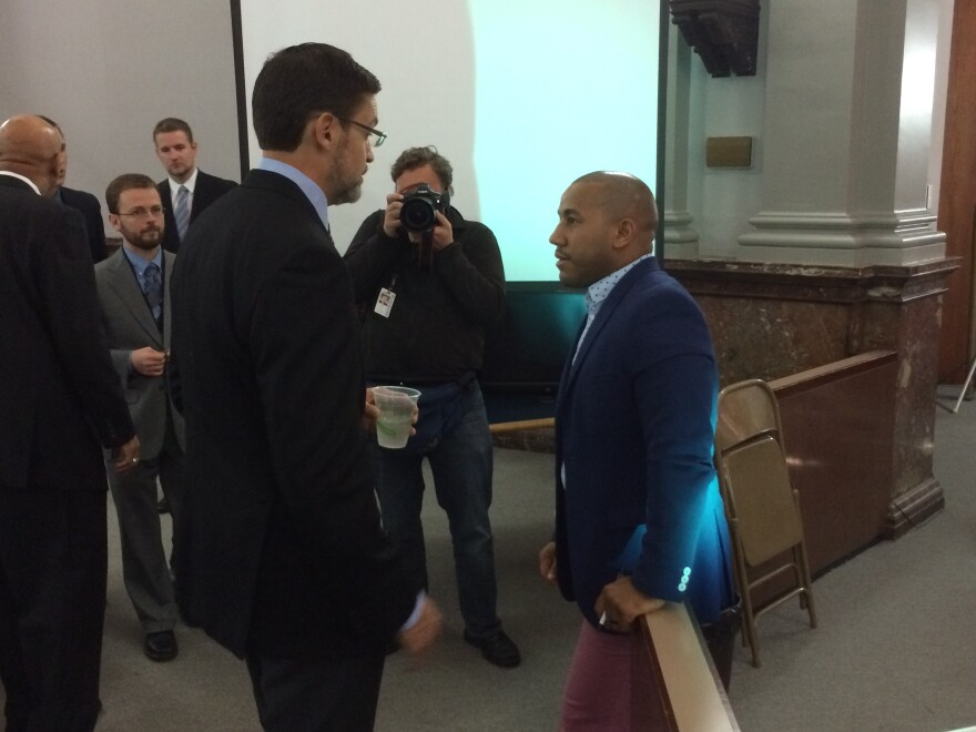 Peacock speaks with Alderman Chris Carter, a 27th Ward Democrat who has expressed some misgivings about the stadium plan.