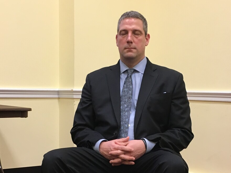 Rep. Tim Ryan, D-Ohio, meditates on Capitol Hill.