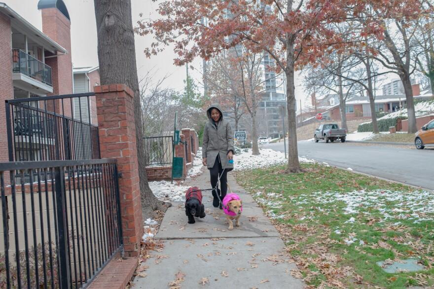 Jaleesa Garlandwalks her dogs around her new Tulsa neighborhood.