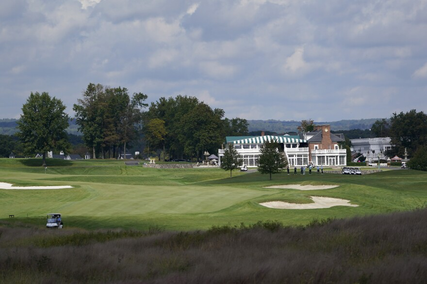 Golfers play at Trump National Golf Club in Bedminster, N.J., Friday, Oct. 2, 2020, one day after President Donald Trump held a fundraiser at the club and later tested positive for the coronavirus.