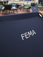 A portable FEMA cot at a temporary medical facility in a gym at Southern New Hampshire University.
