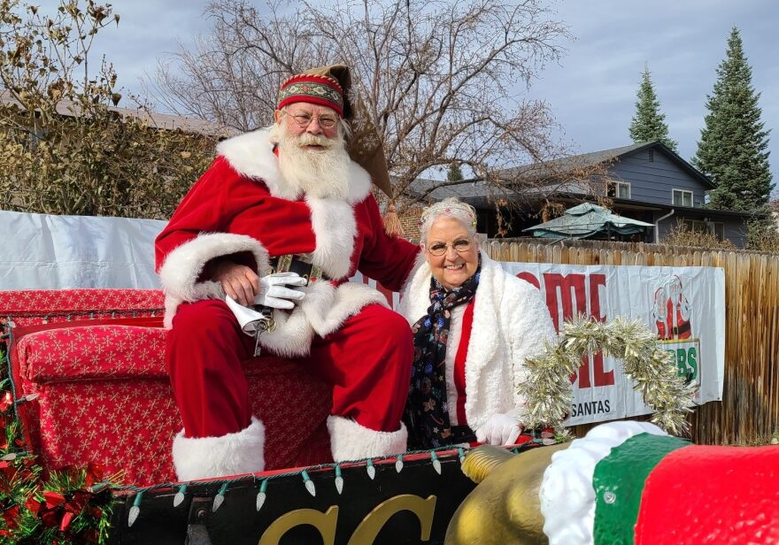 Tom Carmody as Santa this year. During the coronavirus pandemic, he's been sitting on a trailer that his elf friend tows him around on so he can wave hello to the kids at a safe distance. (Courtesy)